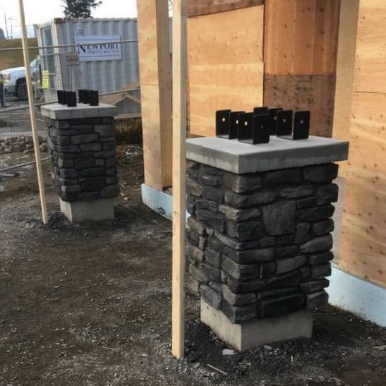 Overhang support pillars clad in charcoal coloured cultured stone